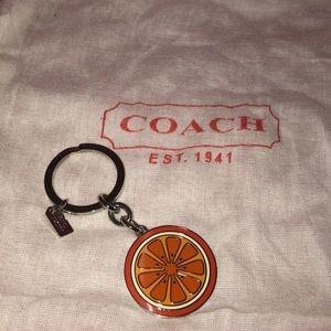 Coach orange slice key ring
